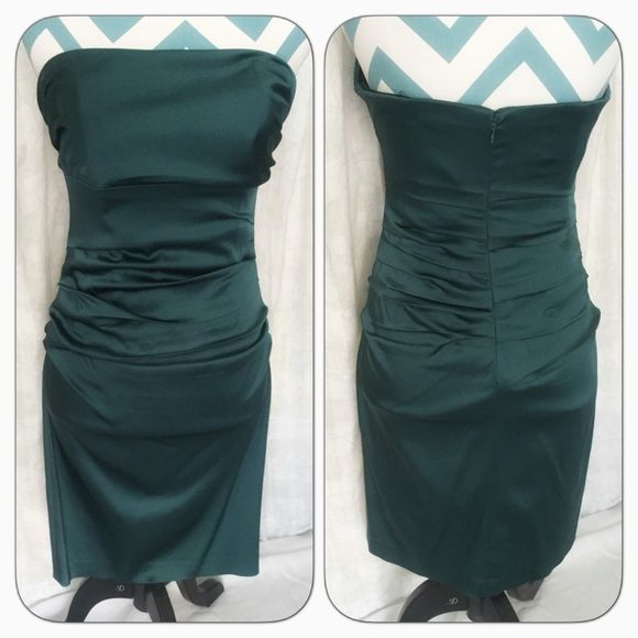Stunning strapless emerald dress 💋 Stunning emerald dress. Ruched through out, super stretchy. Dry cleaned. Few snags and one of the bonings is coming out (easy fix). Priced accordingly. Wore once to wedding like this and believe me it is not noticeable once on. Suzy Chin Dresses Strapless
