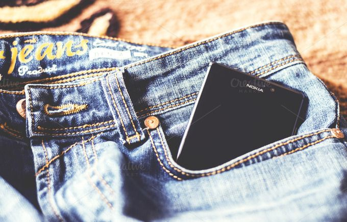 Check out Mobile Phone in Jeans Pocket by Shots By RC on Creative Market