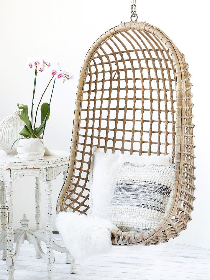 Vintage Rattan Hang Chair | Rattan style wicker hanging chair from the 1960s.  This beautiful and sophisticated piece adds a laidback vibe to any room or porch.  Comes with chain.
