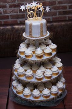 Strike gold with this beautiful cupcake presentation for a 50th birthday.  See more 50th birthday party themes and party ideas at http://www.one-stop-party-ideas.com