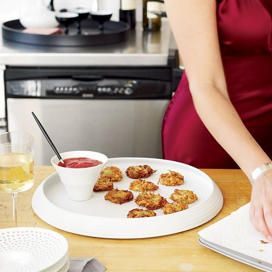 Gail Simmons's mother, Renée Simmons, uses a food processor's shredding disk to get long potato strands that fry up extra-crispy.  Plus: Ultimate H...