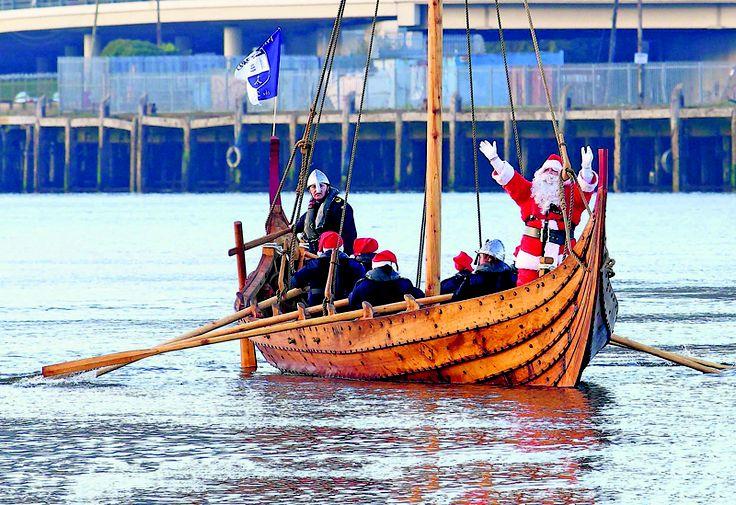 Santa arrives in Waterford by longboat