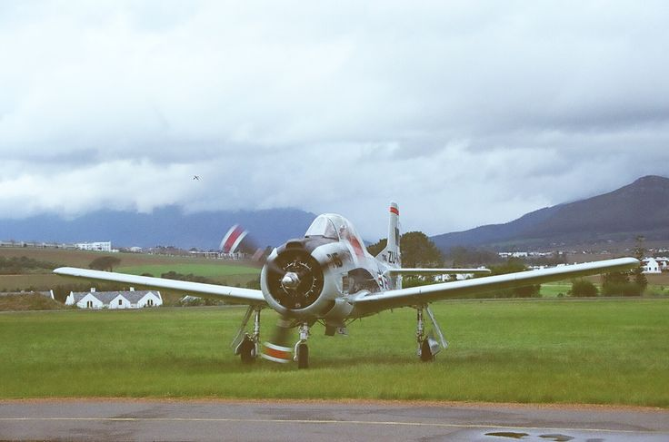 A Moody Start -Trojan T28 at an overcast Stellenbosch Airfield.