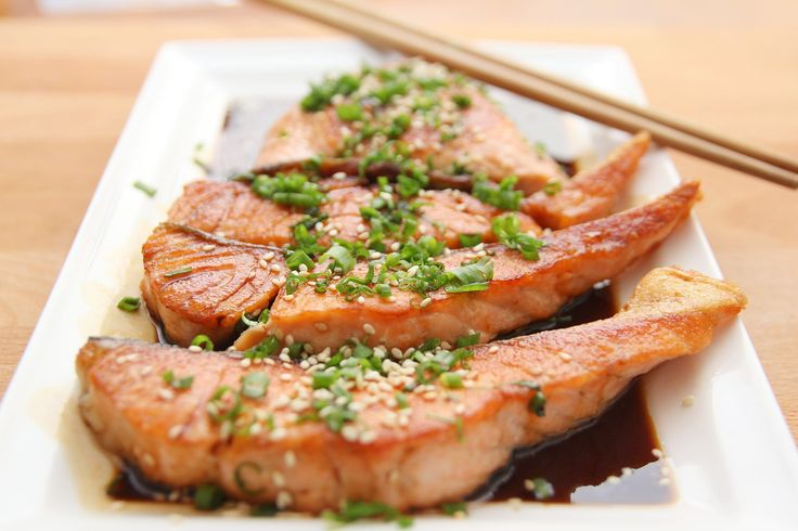 "Honey Sesame Salmon, Serves 4  2-3 lbs salmon fillets  ¼ cup soy sauce, tamari or coconut aminos  ¼ cup sesame oil  1 lemon, juiced  2 tablespoons honey or coconut nectar  1"" of ginger, shredded or 1 teaspoon ginger powder  1 tablespoon coconut oil  2 tablespoons diced green onions or chives  2 tablespoons sesame seeds     	Mix soy sauce/tamari/aminos, sesame oil,"