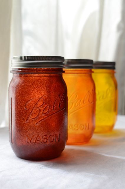 Mason jars are always fun. We can stain them in fall colors and add candles.