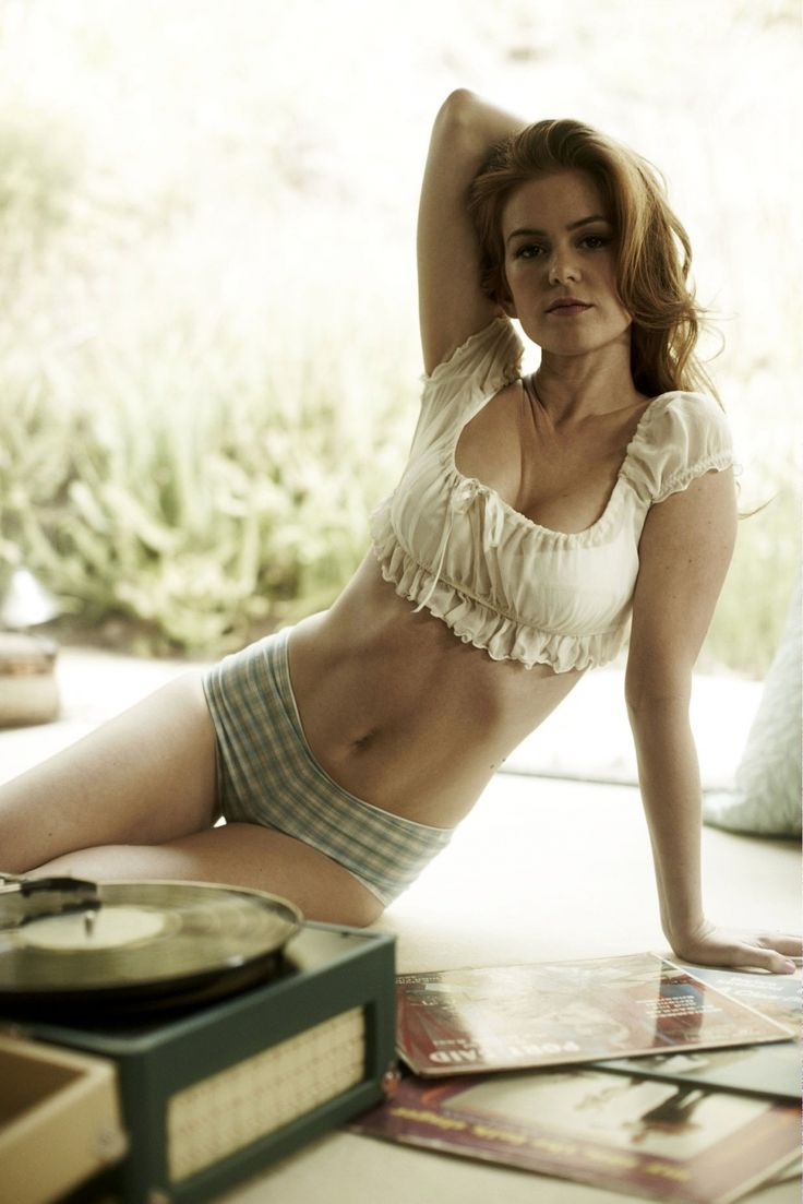 Isla Fisher, she reminds me of Ann Margret here, I wish I had that stomach!