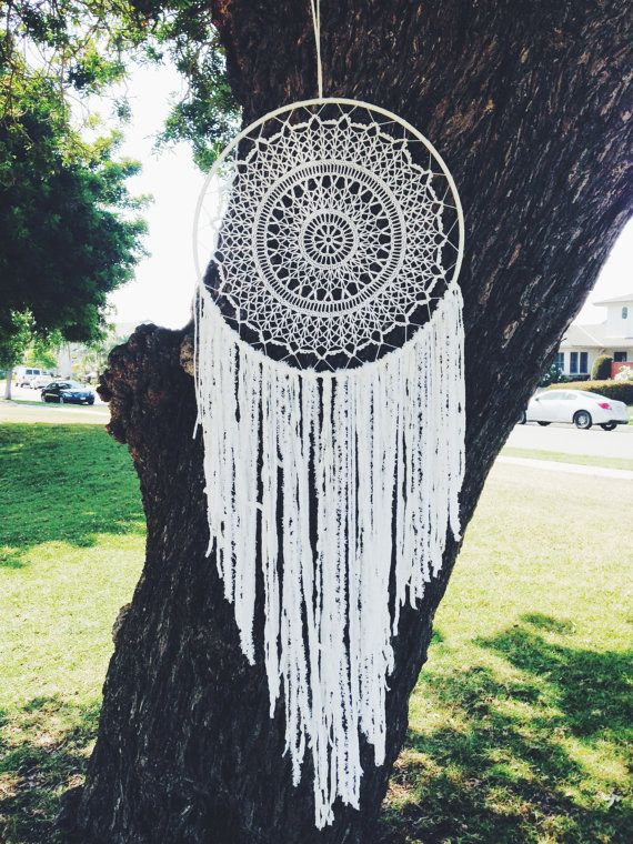 This white dream catcher features a simple combination of white suede cord and a crochet doily. This crochet dream catcher was inspired by dreams of