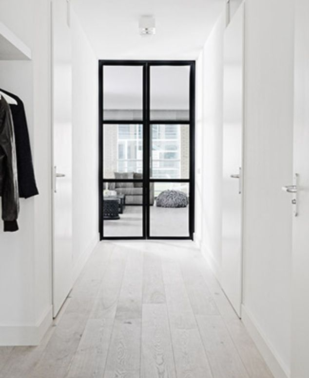 white timber flooring black window frames