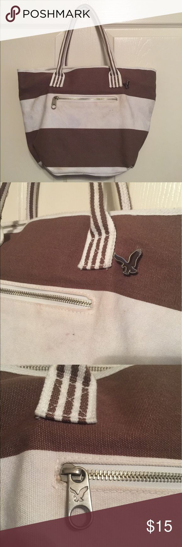 American eagle brown white stripe tote bag woman's Preowned American eagle brown white striped tote bag canvas style. It has some marks on it. Women's Ladies Fashion.  Check out my closet, we have a variety of women's, Victoria Secret, handbags 👜 purse 👛 Aerosoles, shoes 👠fashion jewelry, necklace, clothing, dress, Beauty, home 🏡 .  Ships via USPS. Smoke & Pet-Free. Offers 30% OFF bundle discount. Always a FREE GIFT 🎁 with every purchase!!! Thank you. American Eagle Outfitters Bags…