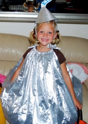 Halloween costume:  Hershey Kiss...wal-mart intertube, shiny silver fabric, ribbon to cinch the material at the neck.