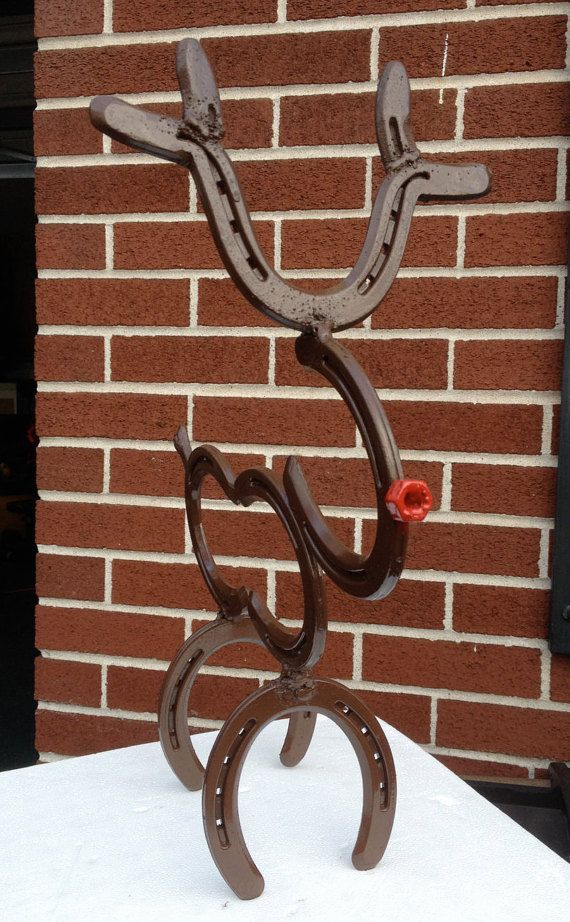 Rudolph the red nose Horseshoe Reindeer made from real horseshoes. Brown finish with red nose.