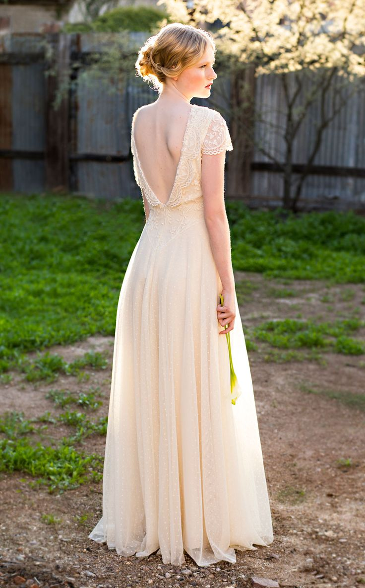 Molly by Martin McCrea | Open back wedding dress. Bodice of leaf-and-vine pattern embroidered tulle with a bateau neckline and collar in front which leads to a deep V lapel in the back. Basque waist connects to a French point d'esprit cotton tulle circle skirt.