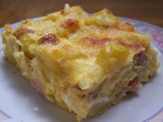 hungarian potato casserole...made with cooked potatoes, smoked sausage, onions, cheese & sour cream