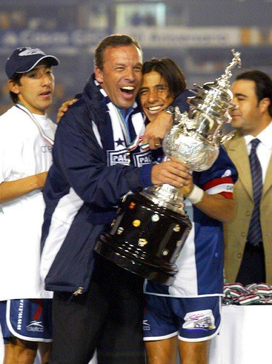 Alberto Rodríguez y Andrés Fassi. Campeones Apertura 2003