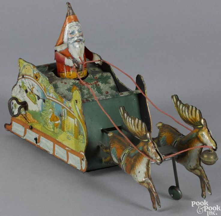 Strauss tin lithograph clockwork Santee Claus toy with reindeer, 11'' l. - Price Estimate: $300 - $400
