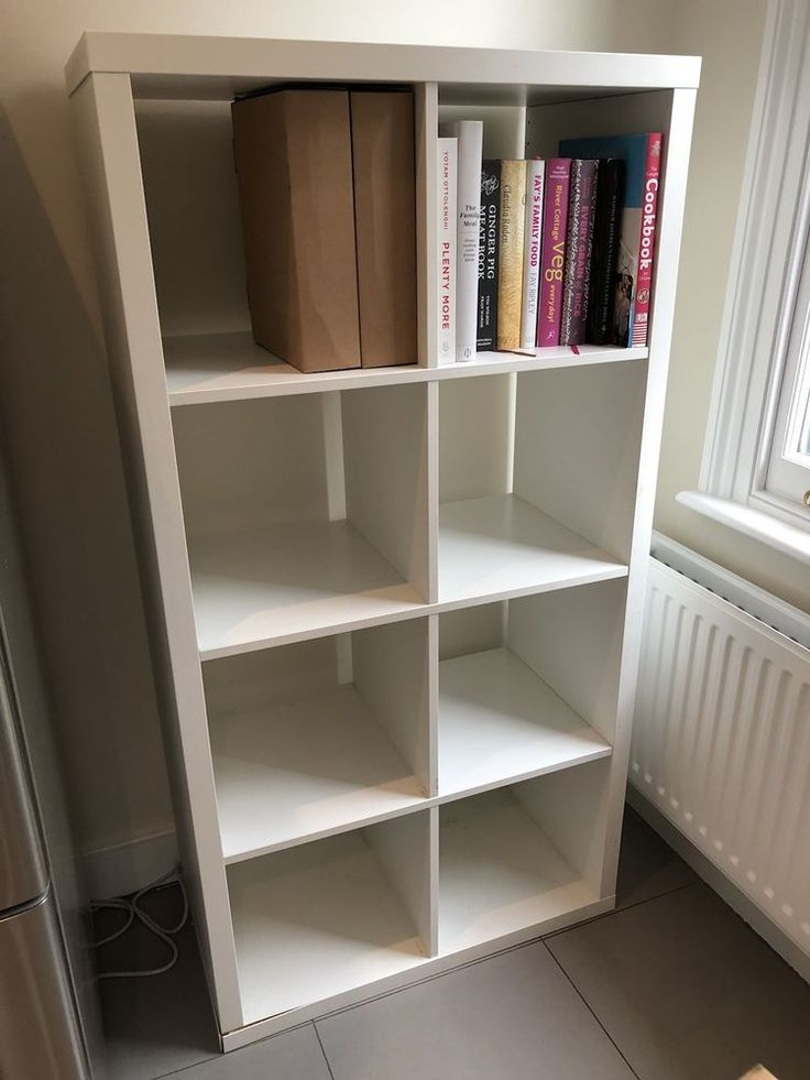 IKEA Kallax bookcase In white. 8 separate box compartments in one unit. White covering peeling away from board in one corner as pictured but otherwise in great condition and very stable. COLLECTION IN PERSON FROM ALEXANDRA PALACE, N22 BOOKCASE ALREADY ASSEMBLED. | eBay!