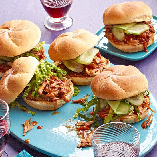 Cola Pulled Pork Sandwiches The key to succulent pork shoulder in this recipe is simmering it in sweet cola, which then becomes a tasty sauce for the shredded meat. If you can, prepare the dish a day ahead for an even richer flavor. #RRSlowCookerMonth