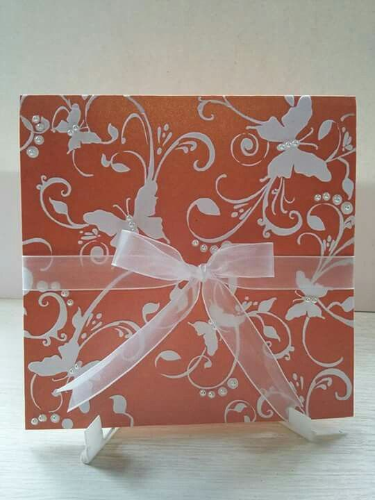 Dainty butterfly design in flocking on shimmery orange card with diamanté and finished with organza ribbon