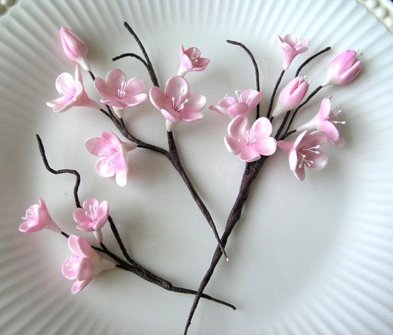 GUM PASTE FLOWERS PINK CHERRY BLOSSOM STEMS These lovely Pink Cherry Blossom stems are perfect for decorating that special cake. All my flowers are made with gum paste which is totally non-toxic, edible and tastes delicious.    Save yourself the time and effort and have me make them for you. THIS LISTING IS FOR 3 CHERRY BLOSSOM STEMS Stems vary in size measuring: approx. 5 to 6 in length x 2.5 to 3 wide. ( If stems are needed shorter, you can snip off some with craft pliers)    These…