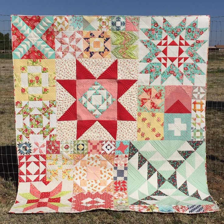 For my birthday last fall, I had @kathleenquilts custom quilt my Moda Modern Building Blocks. She did an amazing job. We had some beautiful weather, and I finally got a photo to share. #afinishbygwen #showmethemoda. The fabrics are all Bonnie and Camille. #bonnieandcamille I used the large floral from Scrumptious for the binding. I love how it ties it all together.