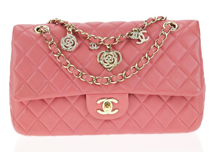 Chanel Pink Lambskin Medium Valentines Classic Flap Bag is the perfect pop of color to add to your wardrobe. This classic flap is featured in soft lambskin leather with gorgeous goldtone hardware. The