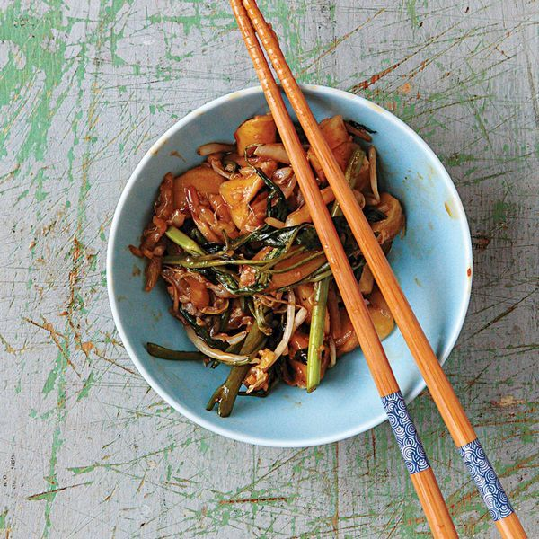 Chewy rice cakes bring delightful texture to this spicy vegetarian stir-fry, perfect for a weeknight meal.