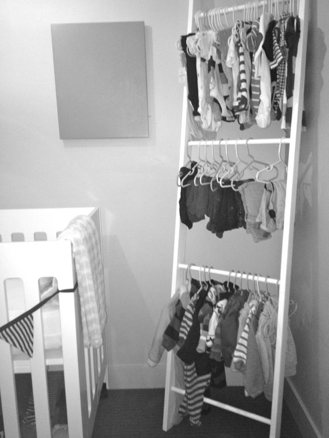 Small apartment?  Use a ladder to hang your baby's clothes!  Or your towels, heels...the options are endless!