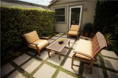 Sometimes minimalism is the best way to handle a small space! These sleek furnishings give a modern flair to this garden. For more ideas on dealing with a small yard, visit: http://www.landscapingnetwork.com/landscaping-ideas/small-yard/