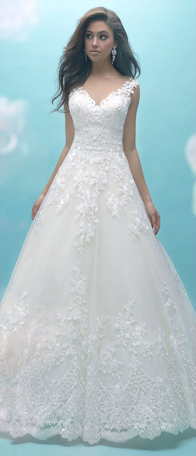 This ballgown features lace appliques across the hemline, bodice and illusion back.