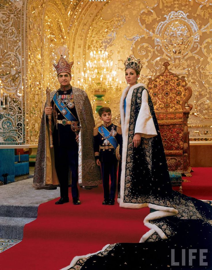 The Shah of Iran, Mohammad Shah Pahlavi, poses with his son, Prince Reza, and wife, Farah, following his coronation in 1967.