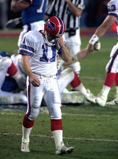 Super Bowl XXV (Giants 20, Bills 19): Dejected Bills kicker Scott Norwood walks off the field after missing a 47-yard field goal on the last play of the game, clinching a victory for the New York Giants.