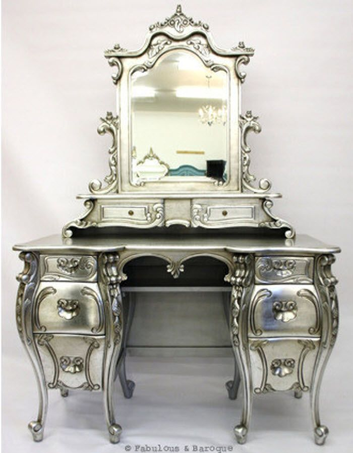 What an interesting thing to do! Glossy silver on an ornate dressing table! You could make a statement piece out of anything with enough shape!