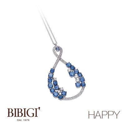 """Collana in oro bianco, diamanti, zaffiri.  La nuova collezione di Bibigì che si ispira al vivere il momento presente, al coccolarsi e concedersi il gusto di un capriccio. Bibigì """"Happy"""" ci emoziona con una miriade di colori che rispecchiano l'allegria dell'anima."""