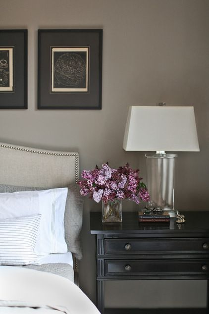 Transitional Bedroom Catherine Kwong - taupe walls, black nighstand, glass lamp