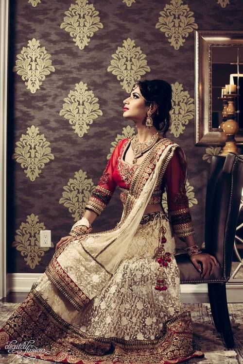 Cream and red bridal lehnga  https://www.facebook.com/nikhaarfashions