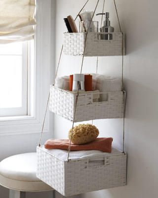 any wall offers triple the storage when you think vertical. loop twine through the corners; knot the top and suspend from a hook to keep items securely and neatly in place: Small Bathroom, Dollar Stores, Bathroom Organizations, Bathroom Storage, Crafts Projects, Bathroom Ideas, Small Spaces, Storage Ideas, Hanging Baskets