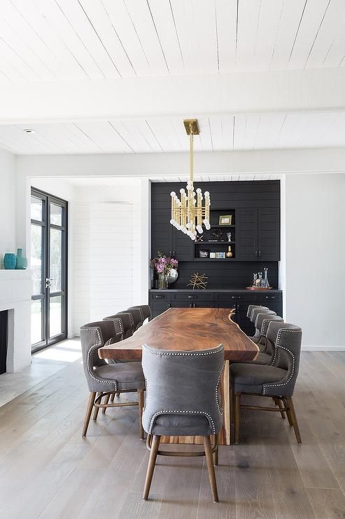 A Jonathan Adler Meurice Rectangular Chandelier Hangs From White Plank Ceiling Over Live Edge Dining RoomsContemporary
