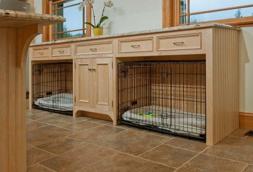 Built-in dog crates. I love this idea for a dog room! The space above and around the crates is utilized instead of being wasted. It is also more attractive than stacked crates.
