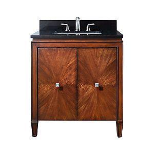 Le meuble-lavabo Brentwood de 31po offre un nouveau fini noyer luxueux et un style transitionnel qui convient à tous les types de salle de bain. Il est fait à la main avec du peuplier massif et du placage en orme, et ses portes assorties à fermeture douce sont dotées de poignées au fini nickel antique. Le meuble comprend un comptoir en granite noir et un lavabo rectangulaire encastré. Des miroirs assortis peuvent également être ajoutés pour compléter lensemble.