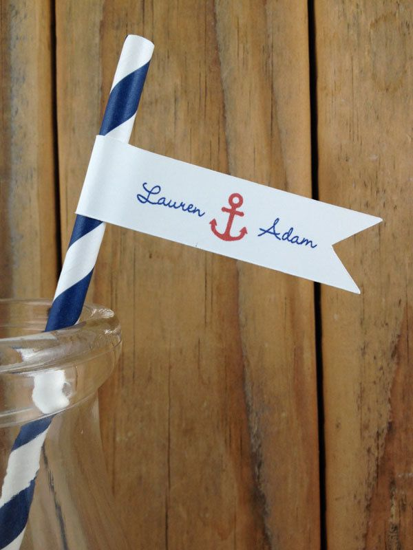 Navy and white straw with attached flag with monogram and anchor for nautical wedding. @myweddingdotcom