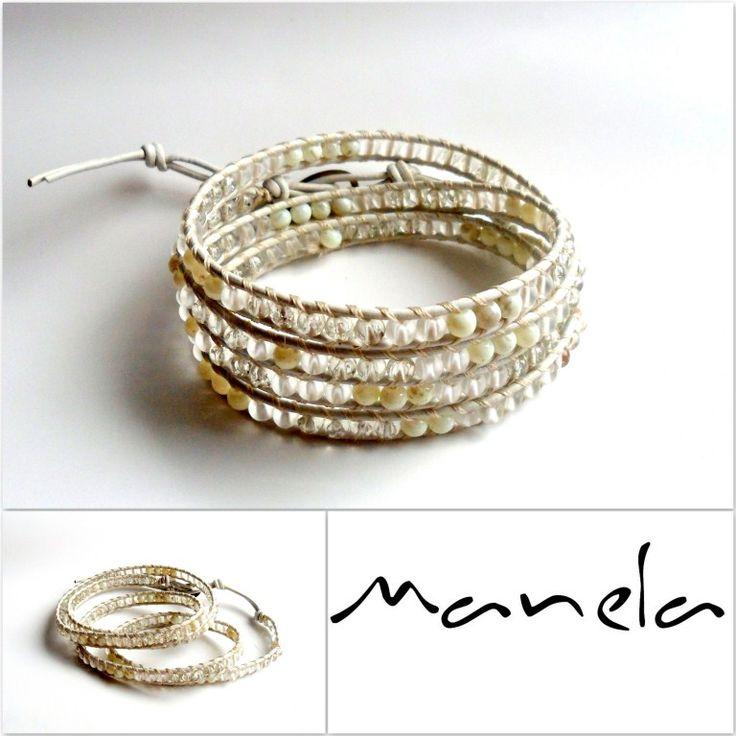 Manele wykonane są z rzemyka z białej skóry, szklanych koralików z przezroczystego i mrożonego szkła oraz polerowanych białych kamieni. Całość maneli zakończona jest zawieszką z nowego srebra z grawerowanym logo.http://manelastylepl.shoper.pl/pl/p/Bride/52
