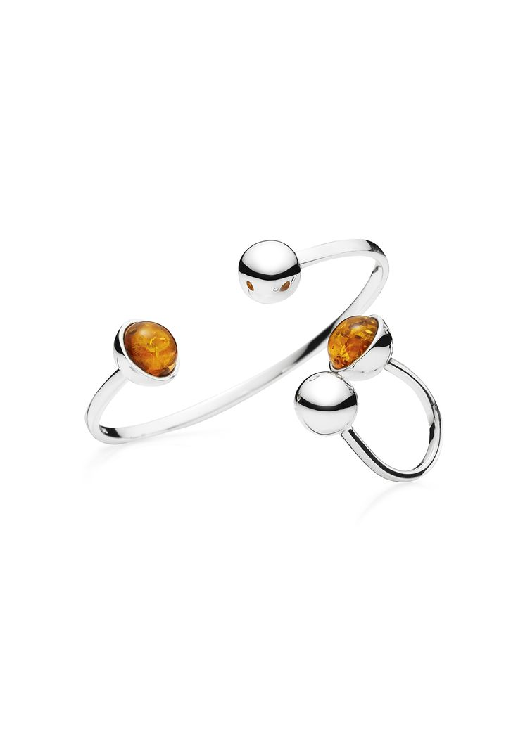 House of Amber by Louise Sigvardt - Image picture of silver bangle and ring with amber.