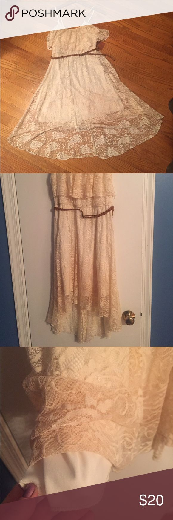Cream Lace High Low Dress Cream colored high low lace dress with slip and brown braided leather belt. Worn twice, no stains, in great condition! Great with cow girl boots or out at a concert! Lily Rose Dresses High Low