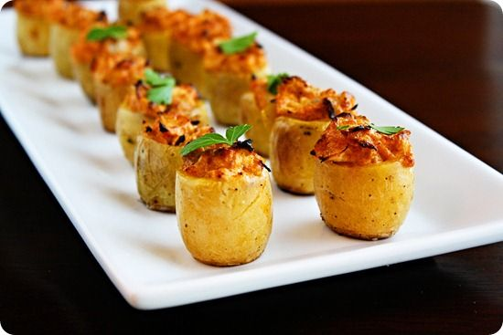 Artichoke Stuffed Baked Potato Bites Recipe Appetizers with potatoes, olive oil, freshly ground pepper, artichoke hearts, light sour cream, parmesan cheese, lemon peel, garlic, crushed red pepper flakes, fresh parsley