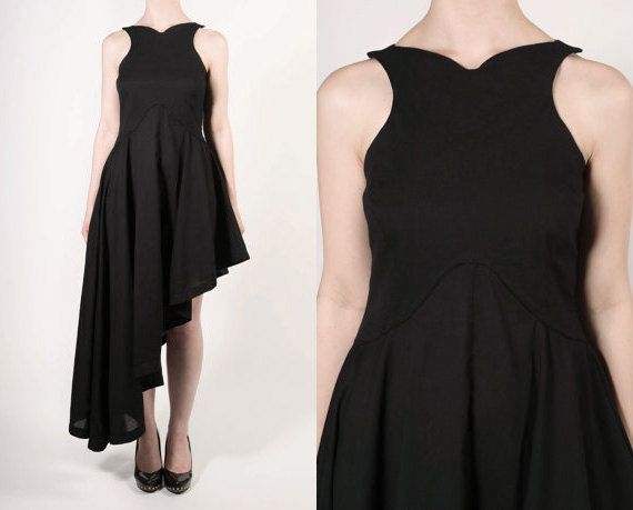 Asymmetric dress with collar bone shaped neckline & waist detailing. Fitted bodice with full, floaty skirt & racer style back. Made from soft & airy 100%