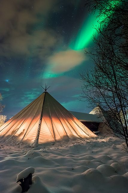 Camping under the northern lights. Troms County, Norway /