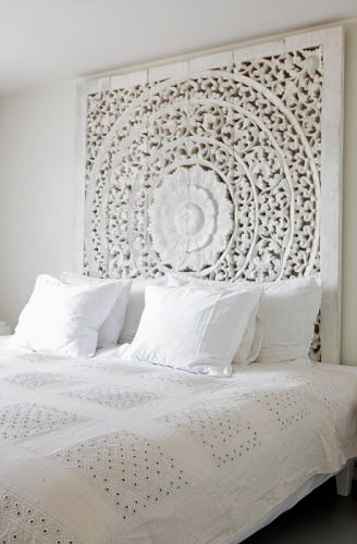 all-white bedroom, love the ornate wood piece!