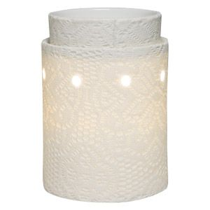 Capturing the elegant details of intricate lace, this innovative warmer is hand-wrapped in genuine lace and dipped in liquid clay before it is kiln fired. In the kiln, the lace is burned away leaving its exquisite detail in the porcelain. To purchase, go to www.jenni.scentsy.com.au