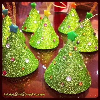 Sun Scholars: Glittered Tree Ornament Tutorial.  These adorable little trees are a craft project that even the kiddos can make to decorate this year's Christmas tree.  They look so pretty on the tree!