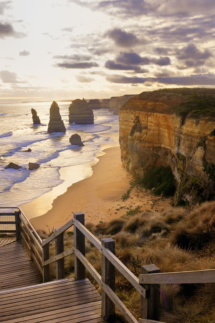 Stairway to the famous 12 Apostles in Australia - magnificent rock stacks that rise up majestically from the Southern Ocean on Victoria's dramatic coastline. There are also 86 steps (Known as Gisbon steps,) carved into the stone that allow access to the beach.  Only then can you appreciate the 70 meter high vertical cliff line and enormous offshore rock stacks.